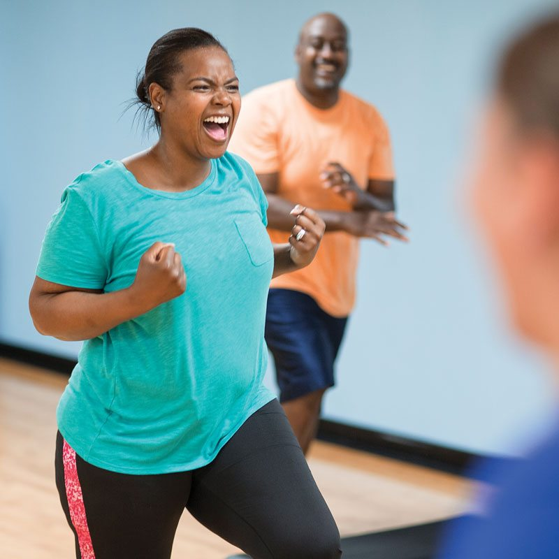 woman pumped up working out in aerobics class