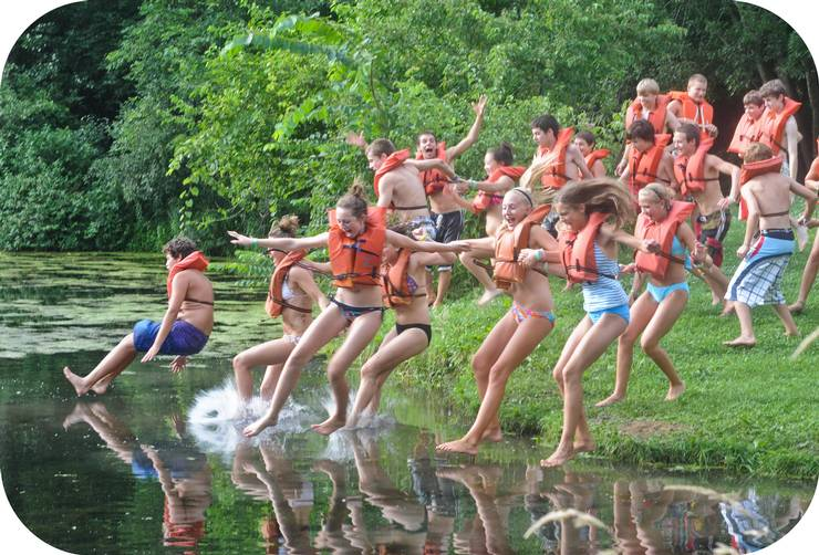 Ranger Camp - Group of teens running and jumping into the water