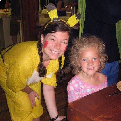 Theme week at camp - young girl with camp leader dressed as pikachu