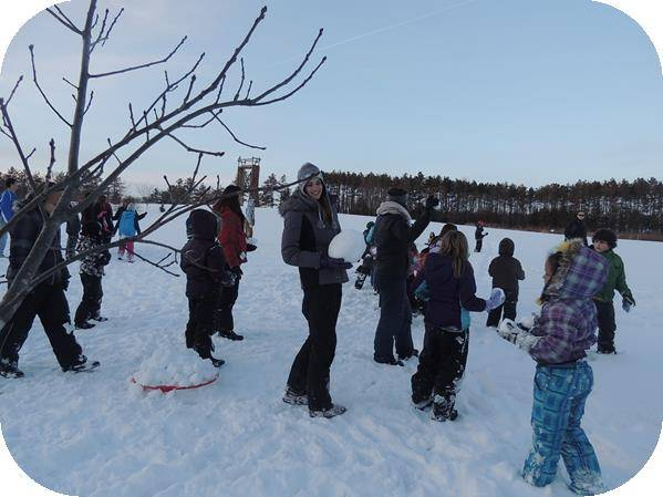 Group of children playing in the snow at Camp Wapsie